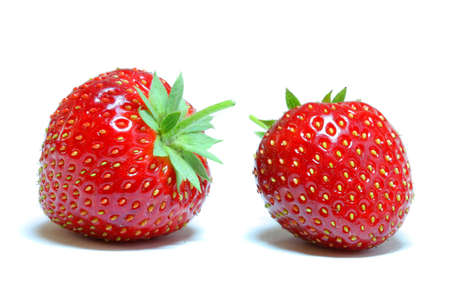 Two organic strawberries isolated on white background