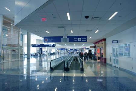 Passengers in bright modern US airport photo