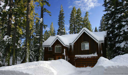 Winter Cabin covered with fresh snow