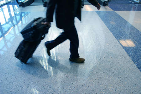 brisk: Man rushing to catch his flight in airport