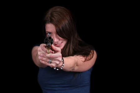 Sexy young woman aiming gun at camera with shallow DOF Stock Photo - 2641037