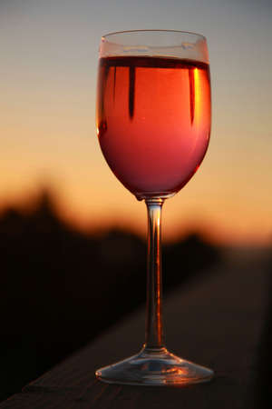 stemware: Glass of Wine at sunset Stock Photo
