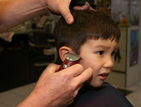 Little boy getting haircut photo