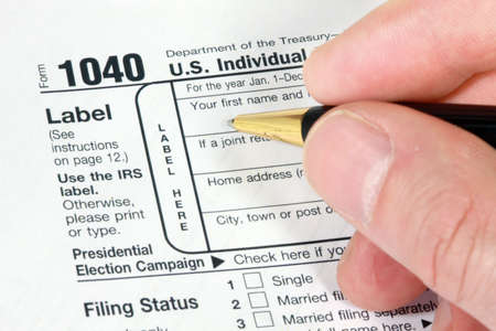 Filling out 1040 Form for tax return Stock Photo