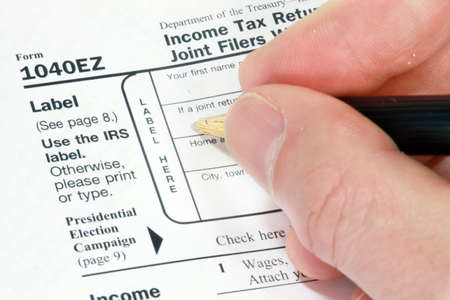 Filling out 1040EZ Form for tax return photo