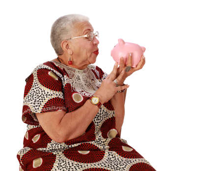 aging american: Retired African American lady with piggy bank Stock Photo