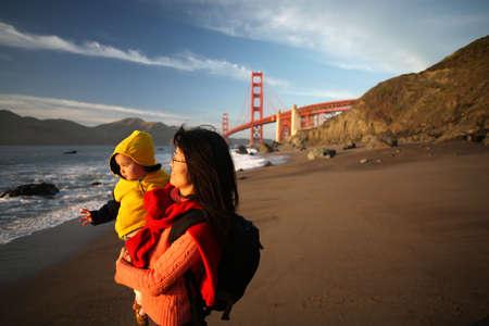 golden gate: Mom and Daughter enjoying sunset on Golden Gate Bridge Stock Photo