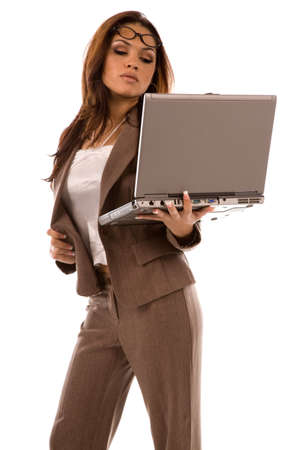 Multi Ethnic young woman holding laptop on pure white background photo