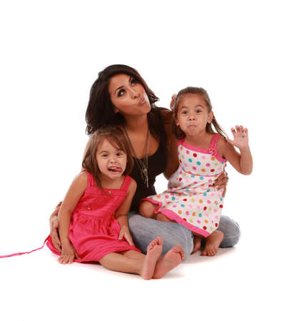 Daughters and mom making funny faces on white background Stock Photo