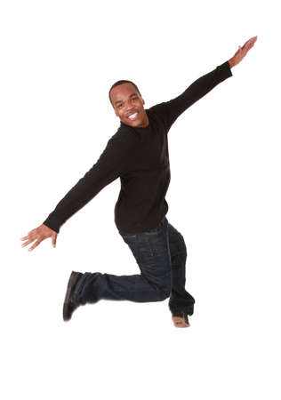 Young man jumping of joy on pure white background