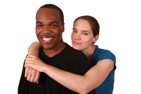 Beautiful multi ethnic couple on pure white background photo