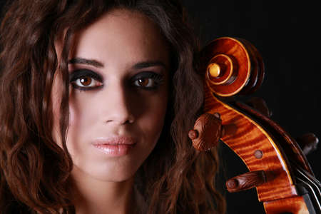 Beautiful Woman with Cello with dramatic lighting Stok Fotoğraf