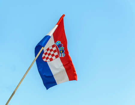 Croatian Flag floating in a clear blue sky
