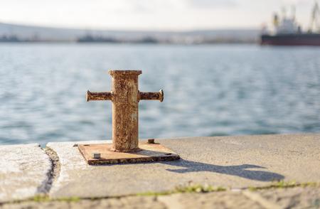 a isolated cross bollard  on the dock