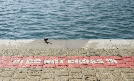 warning paint on the dock floor, do not cross