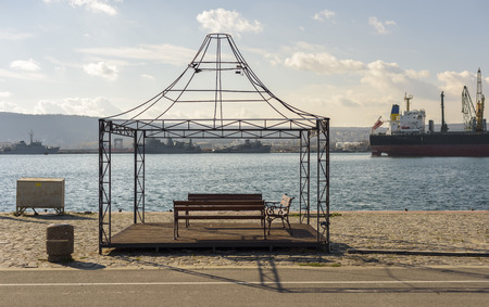 a iron Structure with bench on the dock Stock Photo