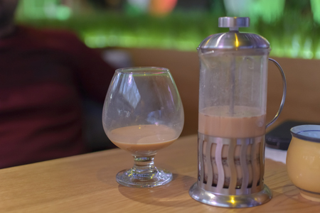 glass and the separator on a table in a bar