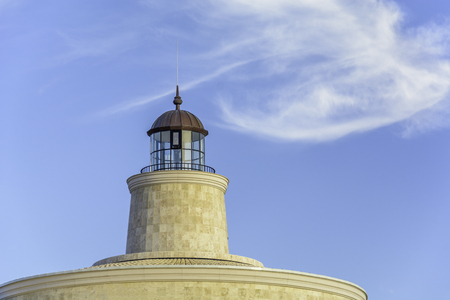 close up of a Lighthouse in a sunny day against blue sky Stock Photo