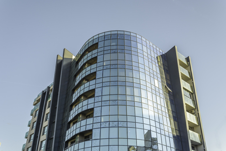 Modern architecture with reflection in glass windows