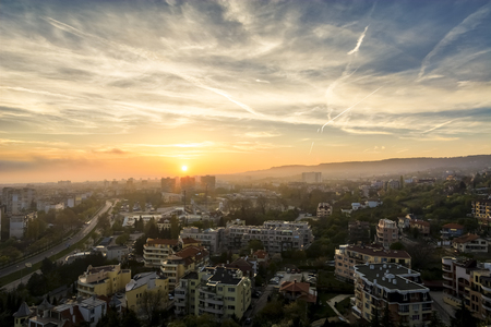 Cityscape of Varna at sunrise, Vibrant sky with fog.