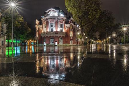 Theater Stoyan bachvarov by night and rain, with reflexion, Varna, Bulgaria