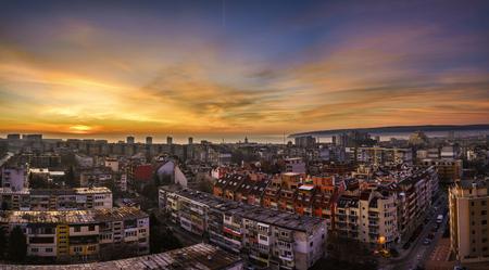 Panorama ot Varna city at Sunrise, vibrant yellow sky Stock Photo