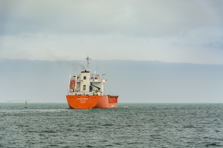Little tanker sailing in the harbor canal in Varna, Bulgaria