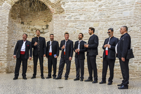SPLIT, CROATIA, OCTOBER 01, 2017: Traditional dalmatian singers , performing under the cathedral dome in Split