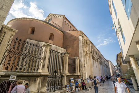 ZADAR, CROATIA, OCTOBER 02, 2017: Tourist walking on the zadar street, surrounding by shop and merchant selling goods and souvenir