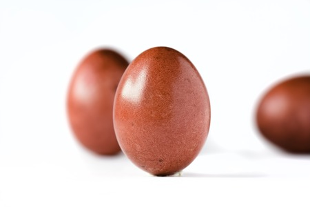 Close up of a red easter egg isolated on white