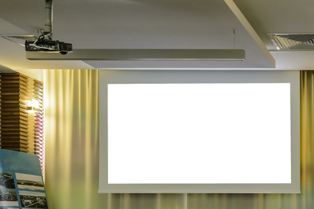 Projector in a room with projector screen on back ground Imagens