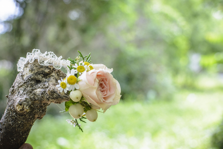 Wedding Floral Bracelet on the grass, with pine cone and roses