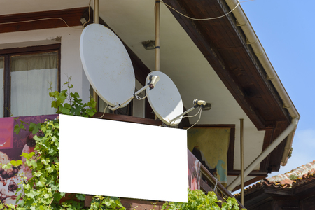 blank sign with two satellite dishes. blank sign with place for tex for your advertising. Stock Photo