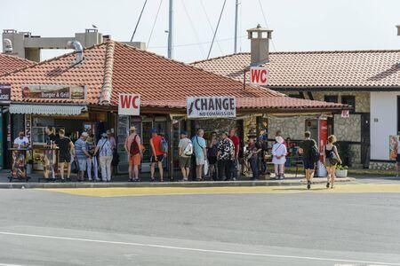 NESSEBAR, BULGARIA , MAI 24, 2018: Tourist waiting in the change office in the city of Nessebar, Bulgaria