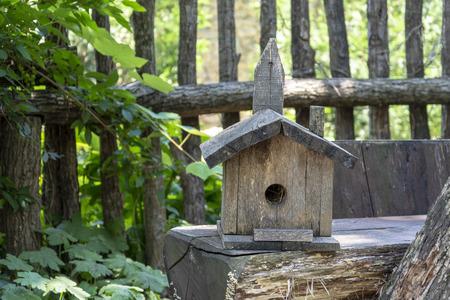 hand made  birds house  wood lying on a table.