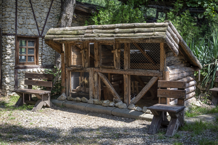 House for rabbit in a forest with benches
