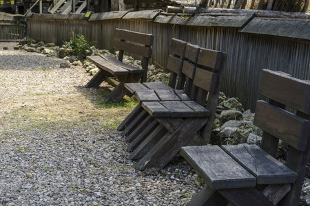 very old bench on a zoo, three benches with massive planks Stock Photo