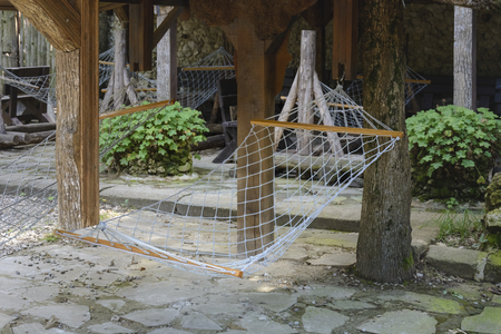 Hammock of rope in a zoo between two trees Stock Photo