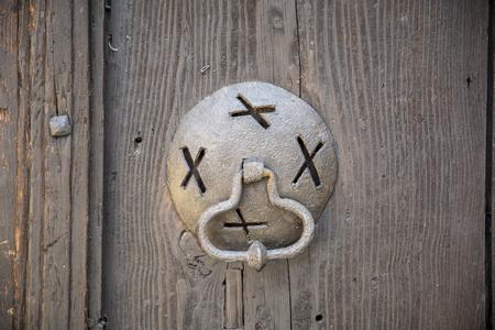 Very old wooden door knocker ,ancient door