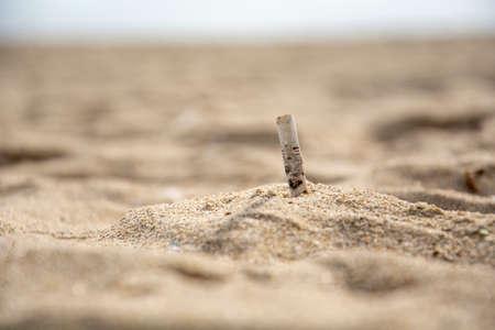 Beer cap on the beach, beer stopper trash on the beach, Stok Fotoğraf
