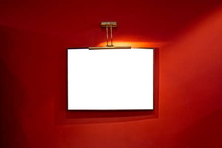 white frame on a red wall, place for text or advertising