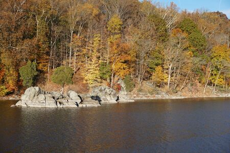 along: Rocks along river bank in autumn