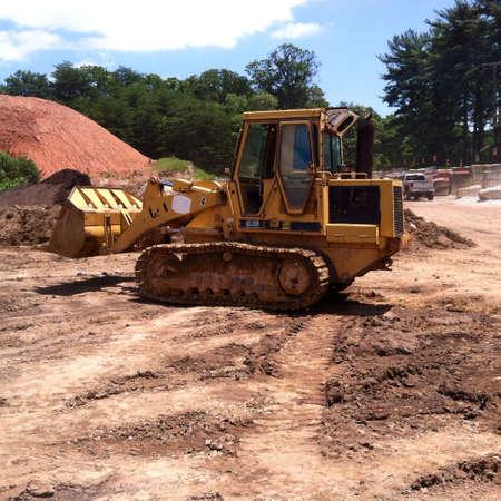 Bull Dozer on a construction site.  Imagens