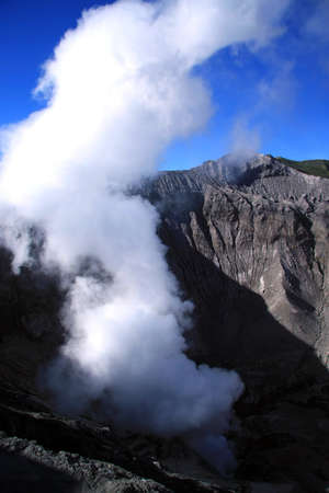 Sulphur smoke erupting from the crater of the Bromo volcano in eastern Java, Indonesia Stock Photo