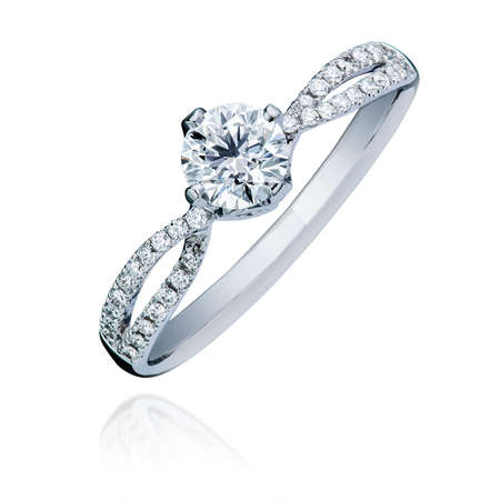 Beautiful diamond engagement ring on isolated white background with faded reflection