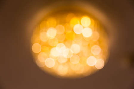 intentionally: Intentionally blurred photo of ceiling chandelier in warm color light