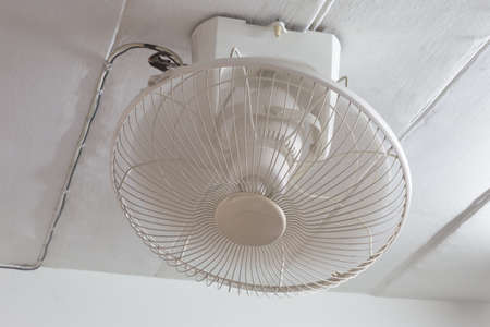 ceiling fan: Mounted white ceiling fan being used Stock Photo