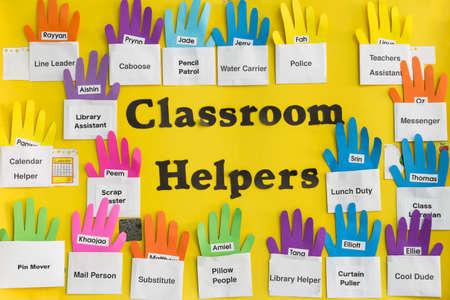 helpers: Classroom Helpers sign, helps teach elementary students about tasks and responsibility Stock Photo