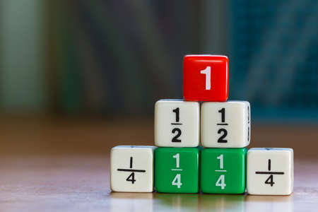 Three levels stacked up color fraction dices, blurred background