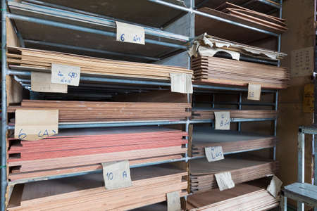 thickness: Racks of stacked construction plywood in various thickness and type